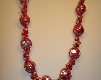 Glass necklace, crocheted, red with sparkling thread
