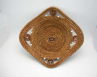 Longleaf pine needle basket with freshwater pearls and sliced walnut shells.