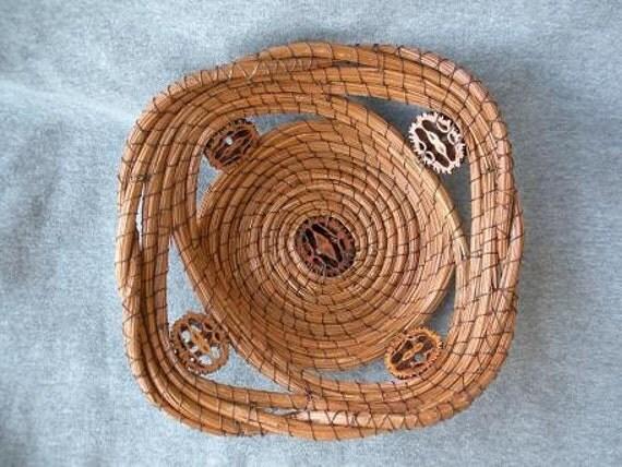 Longleaf pine needle basket with sliced black walnut shells.