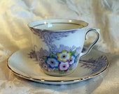 Colclough China Tea Cup and Saucer Violet with Vivid Primary Color Floral