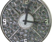 20 inch handmade wall clock. Made from natural black  pebbles and steel.