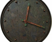 16 inch handmade wall clock. Made from natural multicolored slate and steel.