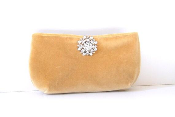 gold velvet clutch  with stunning brooch