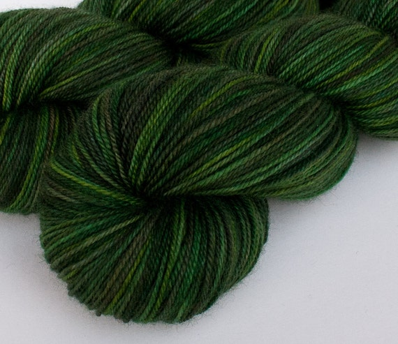 Green semisolid handpainted fingering yarn: NORTH FORK on Blue-Faced Leicester/nylon sock, 4 oz