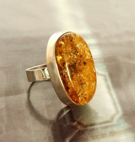 large oval green amber ring, size 8