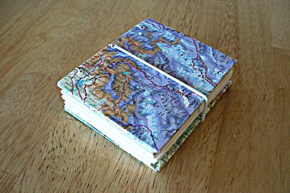 Pocket size map journal with elastic closure. Over 200 pages.