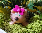 girl hedgehog with bow handmade from polymer clay
