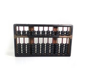 Vintage wooden abacus in black brown and brass