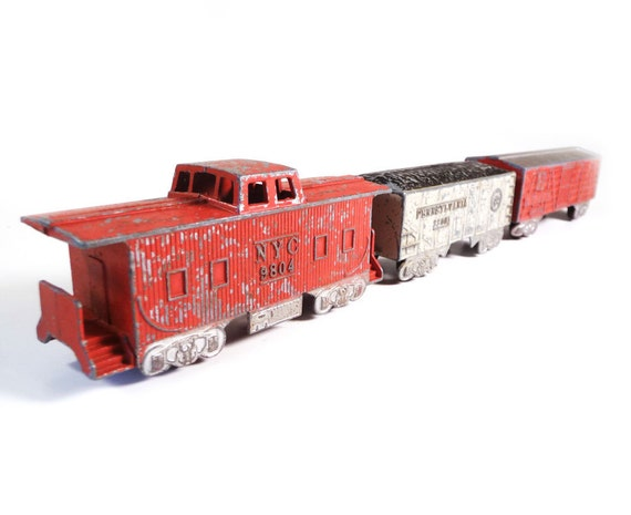Vintage toy train - caboose plus two freight cars