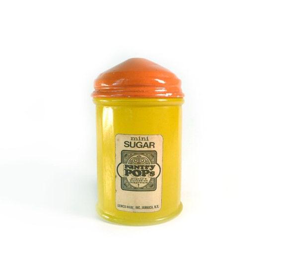 Bright yellow and orange sugar shaker by Gemco