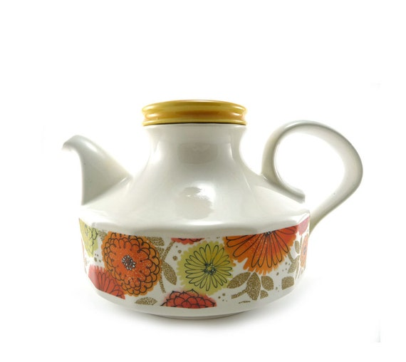 Brightly colored floral teapot, white orange & yellow