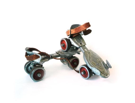 Red and silver Hustler Speed King roller skates