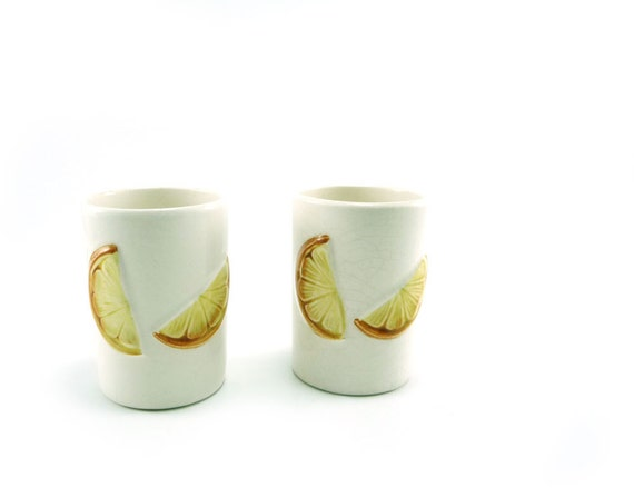 Vintage ceramic saki or juice cups with citrus slices, juice glasses, large shot glasses