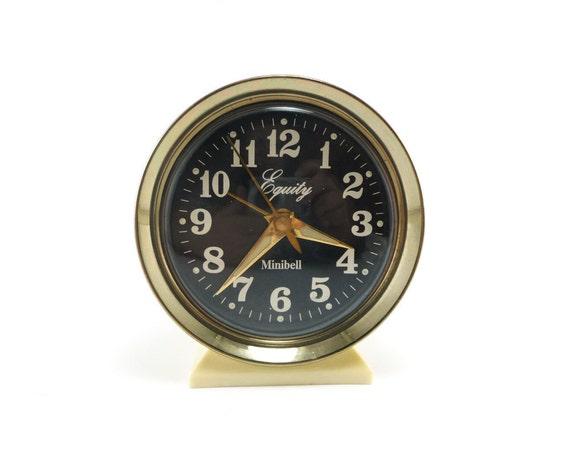 Vintage alarm clock, gold white black with luminous hands