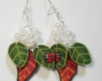 Ladybirds and leaves dangle earrings