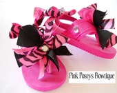 An exclusive one of a kind flip flops by Pink Poseys Bowtique