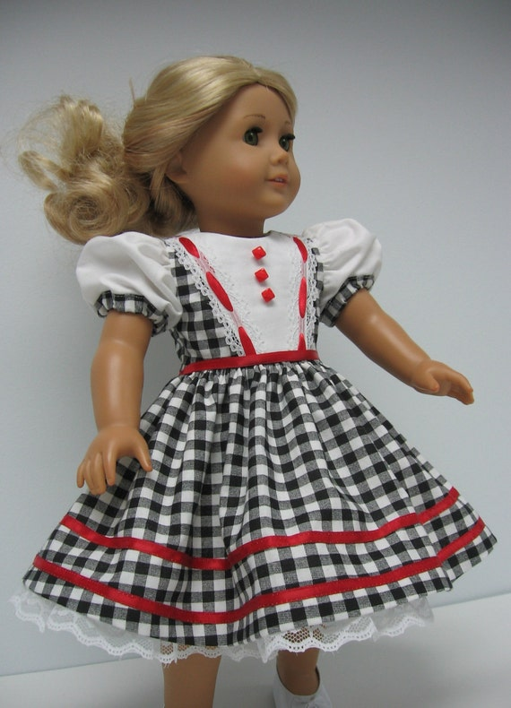 Classic black and white checked dress with red trims