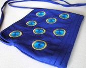 Blue handbag with handcrafted embroidery