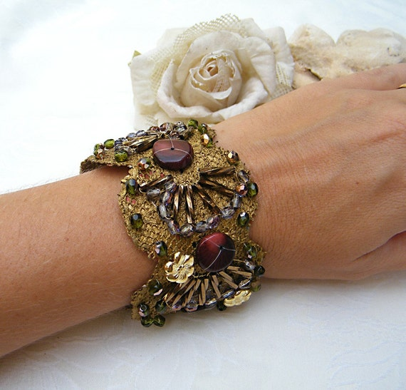 Mintook- Vintage Bracelet, with flat bourgondy beads , gold color metal flowers and long work  beads, all stitched to a ribbon lace.