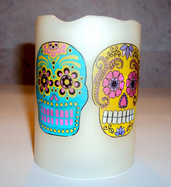 """4"""" Flameless unscented pillar candle with 2 bright colored  Sugar Skulls"""