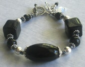 Midnight Serenade Bracelet - Large Glossy Black Beads, Silver Spacers, Seed Beads, Czech Rounds With Toggle And Wire Wrapped Opal Dangles
