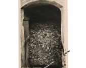 Macabre Vintage Photo / Thousands of Human Skulls and Bones Spilling Out of Ossuary
