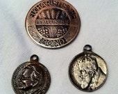 three Christian medals