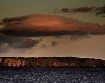 the old head of kinsale with a full moon