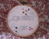 Oh Happy Day fun embroidered wall art displayed in an embroidery hoop.