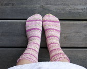 Hand knitted socks in pink and green stripes. Roses.
