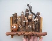 Quirky family tree folk art piece with old fashioned beer tab hanger.