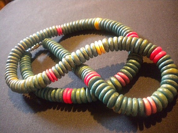 Vintage wooden bead necklace is colorful turquoise blue, yellow, red, purple and magenta red