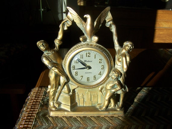 Vintage metal mantle clock with family and eagle marked Windsor Gibraltar would make nice gift for men or women