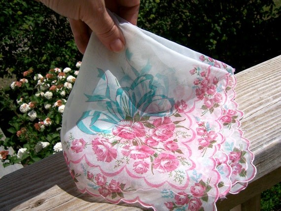 Handkerchief has scalloped edge, pink carnations, roses, teal ribbon, sheer white. Wedding gift idea for mother of the bride or groom.