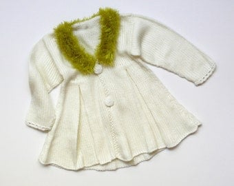 Elegant knitted coat for a baby girl