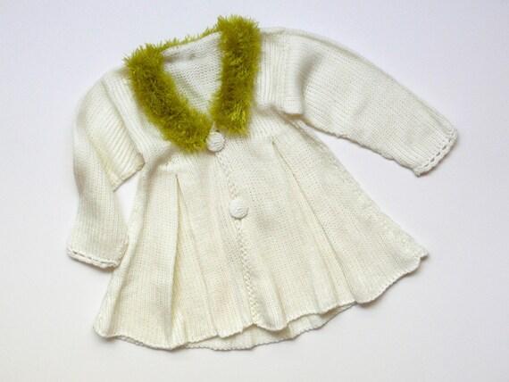 Elegant knitted coat for a baby girl