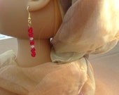Eyecatching red glass and swarovski beaded earring. Flame