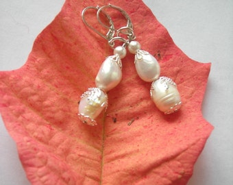 Fresh Water Pearl Earrings.  Cream and Silver Drop Earrings. Pearl Earrings. Cream Earrings. Sterling Silver 9.25. Statement Earrings
