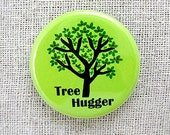 Tree hugger on green. Pinback button 1.25 inch