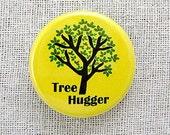 Tree hugger on yellow. Pinback button