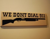 We Dont Dial 911 hanging wall plaque