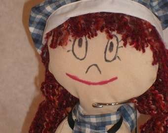 Little chequered doll with red hair