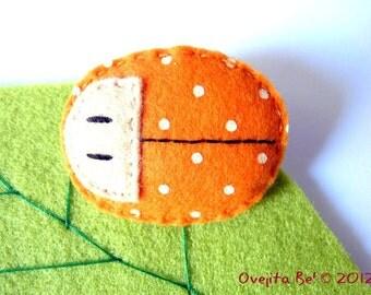 Ladybug felt brooch in orange