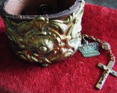 Repousse cuff religious leather bracelet crown cross antique jewelry assemblage one of a kind