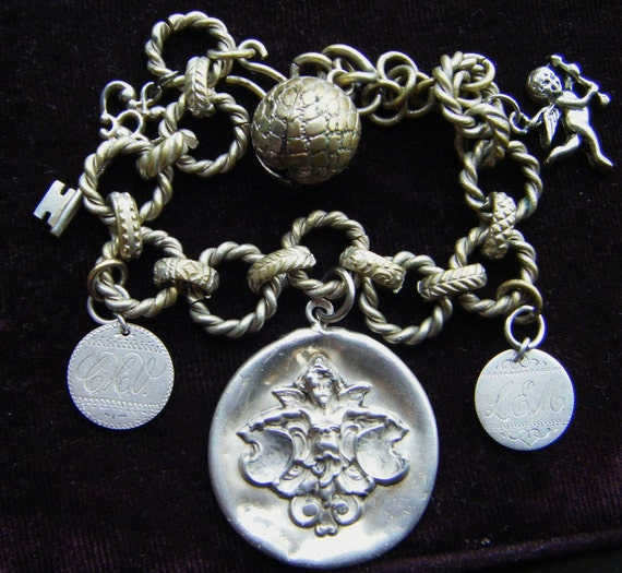 Antique repousse charm bracelet book chain sterling silver cherub victorian love token link assemblage