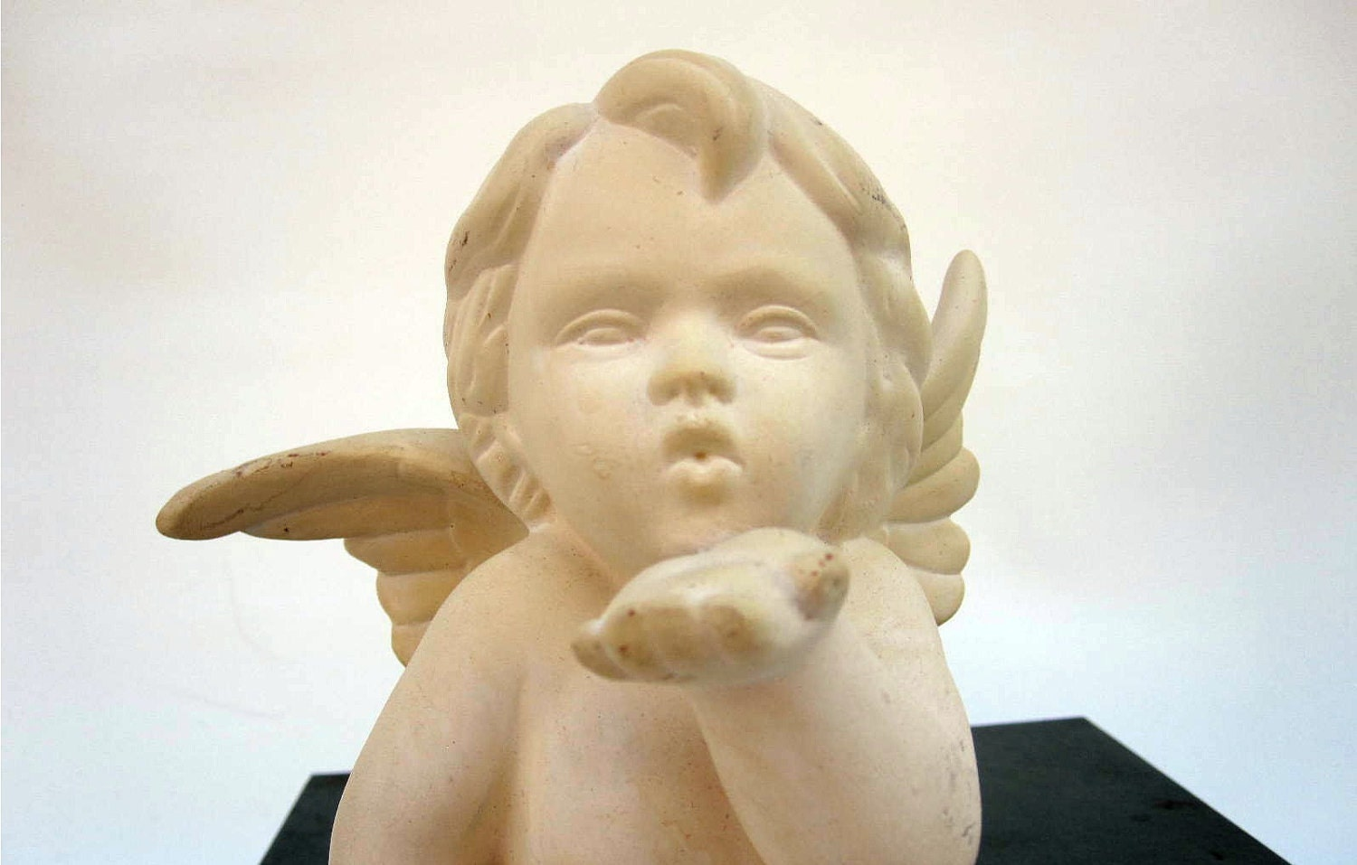 White Angel Cupid Blowing Kiss Ivory Ceramic By