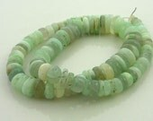 Smooth polished pale blue/ green  peruvian opal rondelles 4-11mm 1/2 strand