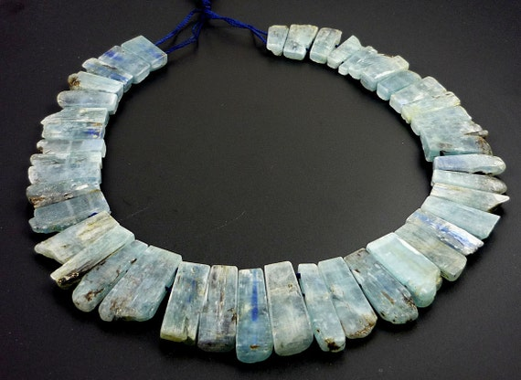 Amazing rough kyanite double drilled plates 15-30mm 1/2 strand