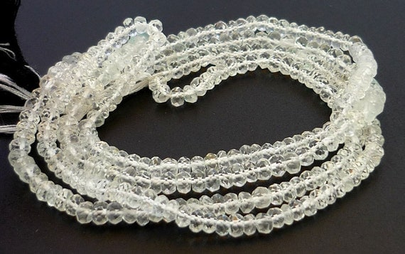 Awsome rock crystal quartz faceted rondelle beads 3.5-4mm 1/4 strand
