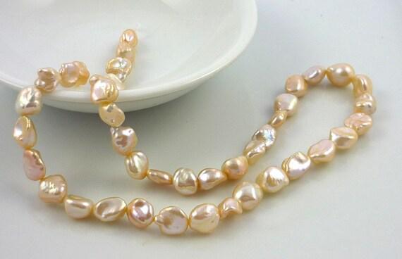 Pretty champagne nugget pearls 6-9mm 1/2 strand